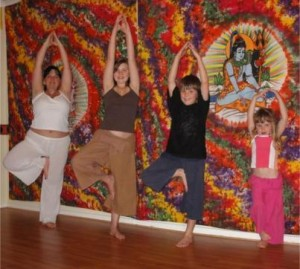 Me with my children practicing Tree posture, vrksasana